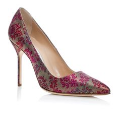 Manolo Blahnik - BB (Brigitte Bardot)  $595.00  Gold fabric pointy court shoe with a spin high heel. Upper: 100% silk satin. Sole: 100% cow leather. Lining: 100% kid leather. Heel measures 105mm. Italian sizing. Made in Italy.   - https://www.manoloblahnik.com/us/products/bb-11207035