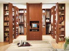 His And Hers Walk In Closet brown design - closets - walk-in closet, huge walk in closet