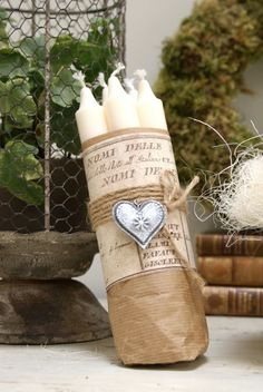 The Swenglish Home...a few tapers bundled in a paper bag or brown paper...a printed page wrapped w/twine or string & a small ornament & you are done! Sweet gestures...