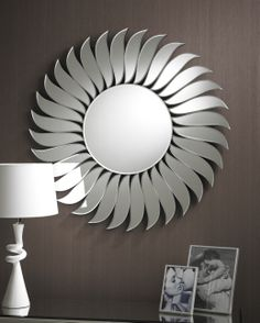 The Wave is a beautiful circular Art Deco mirror made in clear bevelled glass. The simple circle on the inside is surounded by a border of beautiful leaf like bevelled glass sections giving the impression of a flower; a very attractive contemporary mirror. Diameter: 90cm http://www.totalmirrors.com/round-mirrors/180-art-deco-round-wave-mirror-90cm-diameter-5055157621788.html