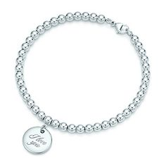 """Tiffany Notes """"I Love You"""" disc charm in sterling silver on a bead bracelet."""