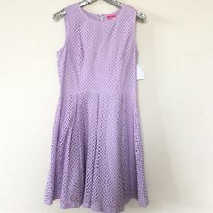 """Betsey Johnson Lavender Eyelet Dress, size 10 Betsy Johnson Lavender Eyelet Dress. Gorgeous lavender color with a back zip and beautiful back. Size 10.   Lined and not see through. Measurements laying flat:   bust measures at 19.5"""" waist 16"""" and the length is 39"""". Material is 100% cotton. Brand new with tags attached.  Retail $125 Betsey Johnson Dresses"""