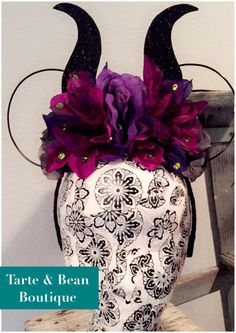 Maleficent Inspired wire Flower Mouse Ears horns Headband minnie by TarteandBeanBoutique on Etsy https://www.etsy.com/listing/250476945/maleficent-inspired-wire-flower-mouse