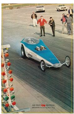 The Super Mustang - Ford's factory participation in drag racing after the 428 OHC motor lost favour to the simpler, more powerful aluminum blocked Ed Pink & Donovan Hemi's