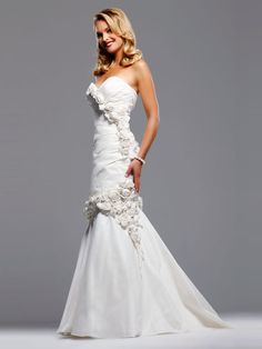 wedding dresses with detatchable trains | wedding dress with hand make flowers and pleats mermaid dress
