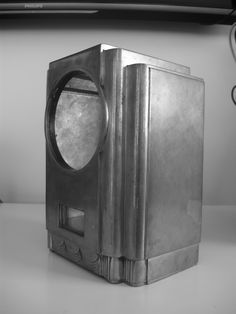 FJ1 case. Cast in one piece. A tin alloy. Definitely not made of steel as some state...