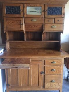 kitchen antique cupboard with pull out cutting board, flour bins, many drawers and storage. can be used in entry way or mud room for storage and nice conversation piece. comes in 2 pieces, bottom and top that sits. solid wood. beautiful piece and sad to sell.