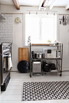 Using a wheeled kitchen cart to keep small appliances together and save counter space.