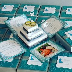 Elegant custom pop-up Boxed Wedding Invitations with 3-Tier Square Cake embellished with intertwined rings cake topper, miniature doves floaters and crystal/rhinestomes cake trimmings. Carefully handcrafted handrafted by JinkyCrafts.