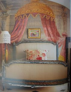 A painted backdrop is a scene from an opera produced at the Paris Opera House around the turn of the century. The bed, believed to be 18th century  French, is upholstered in raw silk.