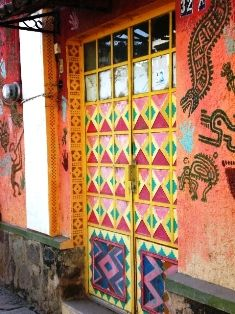 """A door that Would Make the Aztec Gods Smile in Ajijic.  Painted by Canadian artist, John Richmond or 'Juan Compo."""""""