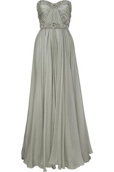 Light gray iridescent silk-chiffon full-length strapless gown. Marchesa gown has a boned ruched bustier, transparent crystal embellishment, a slight sweetheart neckline, a slight V-back, is gathered at the waist,