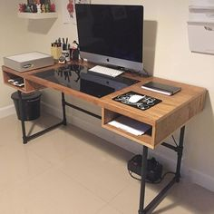 Industrial design desk with steel pipe legs and an embedded plexiglass for the ideal drawing space.: