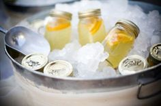 Drinks in mason jars on ice for guests to grab! Other ideas from this site: chalk paint so guests can add their name OR little tags for either the name of the guest or the drink (or both...)