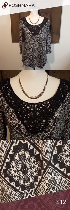 NY Collection 3/4 Length Sleeve Top NY Collection black and white top. 3/4 length sleeves. Black crochet detailing on scoop neckline. In good used condition. Minor pilling on the fabric, not visible with the pattern. 97% polyester and 3% spandex. NY Collection Tops Blouses