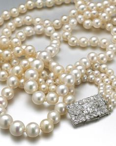 An impressive three-row natural pearl and diamond necklace, mounted by Cartier, Sold for US$ 600,000 inc. premium.
