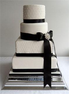 square and round layered wedding cake