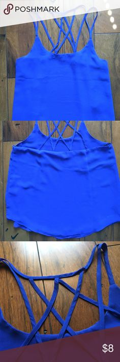 Blue tank top with back detail Vibrant blue tank top with unique strap detail. Flowy fit. Only worn once. Great for going out! Would look super cute with black jeans and heels. Feel free to ask questions or make an offer! 😊 Tops Tank Tops