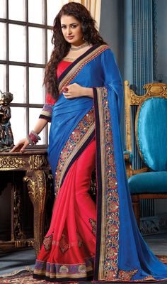Incite your admirers to bask in your glory with this blue and red color net chiffon satin half n half sari. The lace, patch, resham and stones work appears to be chic and excellent for any function. Upon request we can make round front/back neck and short 6 inches sleeves regular saree blouse also. #RichHeavyBorderWorkSaree