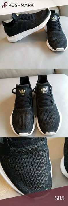 WOMRNS BLACK WITH GOLD ADIDAS SNEAKERS LIKE NEW WORN HANDFUL OF TIMES ADIDAS WRITTING INSIDE IS FADING PLEASE SEE PICTURE  STILL LOOK BRAND NEW  SO COMFORTABLE JUST CLEANING OUT CLOSET   🦉PRICE IS FIRM🦉  WOMENS BLACK ADIDAS SNEAKERS WITH GOLD   SIZE 8 1/2   BUNDLE TO SAVE ON SHIPPING 🚫NO LOWBALLING🚫 🚫LOWBALLERS WILL BE BLOCKED🚫 🚫PLEASE DO NOT SEND RIDICULOUS OFFERS🚫 🚫I WILL NOT RESPOND🚫  THANK YOU FOR LOOKING ADIDAS Shoes Sneakers
