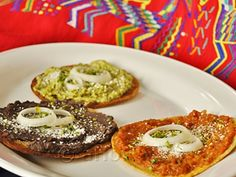 Tostadas. These are Guatemalan antojitos, or snacks. A fried corn tortilla with one of three topings: Tomato Sauce, Guacamole or Pureed Black Beans. These are topped by cotija cheese, an onion slice and chopped parsley. Yum!