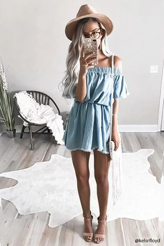 A chambray mini dress with an elasticized off-the-shoulder neckline, short frayed sleeves, a frayed hem, and a flowy silhouette.
