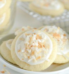 Coconut Meltaway Cookies-These Coconut Meltaway Cookies are crazy soft and literally melt in your mouth with their simple soft shortbread base. They are topped with a little coconut milk frosting and toasted coconut. This recipe is perfect for an after school sweet treat, a picnic dessert or summer time fun snack. They would be a hit at a school or church bake sale and holiday cookie exchange as well.