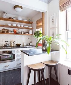 Kitchen Lighting Ideas Such a tiny kitchen, yet the open shelving makes it feel bigger! - If you've convinced yourself that white kitchen cabinetry is totally boring and Kitchen Interior, New Kitchen, Kitchen Dining, Kitchen Decor, Kitchen Layout, Compact Kitchen, Kitchen Lamps, Basic Kitchen, Studio Kitchen