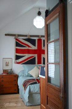 Rustic Bedroom reveal featuring a Union Jack Flag mounted on an Antique Pulley and cedar rail… CynthiaWeber.com