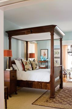 Match dark wood with a light hue, such as this shade of blue, to balance the weight of the furniture in the room. Wall paint: Fantasy Blue by Benjamin Moore Blue Wall Colors, Bedroom Wall Colors, Blue Bedroom, Master Bedroom, Dark Wood Bed, Dark Wood Furniture, Bedroom Furniture, Blue Rooms, Blue Walls