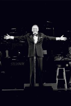 Title: Frank Sinatra Caption: American singer and actor Frank Sinatra (1915 - 1998) performing on stage.   Artist: Terry O'Neill Date: 1970  Copyright: © Terry O'Neill