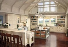 Gorgeous kitchen. I would take out the shelves on the outside wall and make it all windows! Pretty!