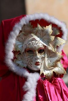 Close-up of a person wearing a sophisticated Venetian disguise during the Carnival days.The Carnival of Venice (Carnevale di Venezia) is an annual festival, held in Venice, Italy and is now established as one of the world's most colourful must-see events. Stock Photo