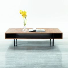 Zen simplicity makes this table a beautiful and modern addition to your space. The open form of the table lets light and air flow through its center, a counterpoint to its deep, classic walnut veneer.