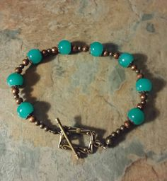 A beautiful Jade green glass bead with copper detail handmade bracelet, by SpryHandcrafted on Etsy Diy Bracelets How To Make, Make Your Own Bracelet, Homemade Bracelets, Bracelet Making, Paracord Bracelets, Beaded Bracelets, Selling On Pinterest, Handmade Beads, Rose Quartz