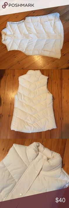 White GAP puffer vest Never been worn cozy vest! Zippers up then snaps hide zipper. GAP Jackets & Coats Vests