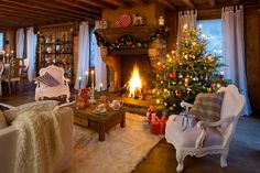 Christmas in a cottage with a fireplace.