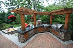 Pergola over an outdoor kitchen by The Pattie Group.
