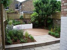 Garden design in London by Jenny Bloom Garden Design. Small sunny contemporary courtyard garden design in north London with rendered raised bed, circular hardw… Small Courtyard Gardens, Modern Courtyard, Courtyard Design, Small Gardens, Outdoor Gardens, Garden Design London, London Garden, Design Cour, Contemporary Garden Design