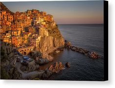 Manarola Dusk Cinque Terre Italy Canvas Print by Joan Carroll.  All canvas prints are professionally printed, assembled, and shipped within 3 - 4 business days and delivered ready-to-hang on your wall. Choose from multiple print sizes, border colors, and canvas materials.  Visit joan-carroll.pixels.com for more #art #photography #fashion and #homedecor items from #ITALY and around the world! @joancarroll +JoanCarroll