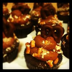Chocolate-covered pretzel cupcakes with salted chocolate frosting