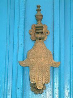 Hand of Fatima; Hamsa. A good luck door knocker.