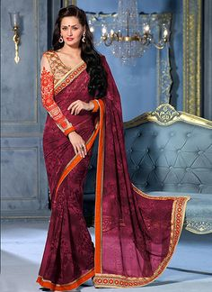 Grab the second look in this elegant attire for this season. Look sensationally awesome in this wine georgette designer saree. This attire is showing some really mesmerizing and innovative patterns em...