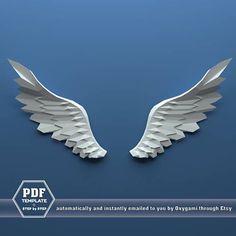 Esto es un imprimible plantilla PDF que se convertirá en 3D grande grande alas usando tijeras y pegamento. El movimiento y las curvas de estas llamativas alas agregarán algunos bits extras de gracia a su habitación. Sobre la cama de su adolescente soñador, estas alas poderosas adaptan