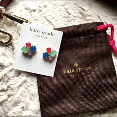 Kate Spade Cluster Earrings NWT-Kate Spade cluster earrings!  Round and oval stones set in gold colored posts.   Fun earrings to brighten up a t-shirt and denim.  Comes w jewelry pouch shown kate spade Jewelry Earrings