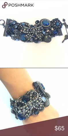 RARE Betsey Johnson Wide Toggle Bracelet Rare Betsey Johnson wide toggle bracelet. Gunmetal color with dark blue accents. No damage/signs of wear/missing stones/etc. Perfect condition. Betsey Johnson Jewelry Bracelets