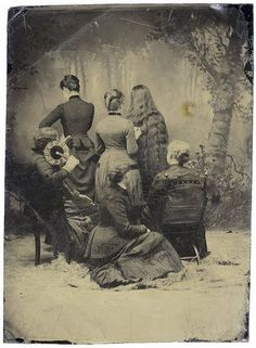 Probably a mourning photograph.  It was customary to hide your face when in mourning.