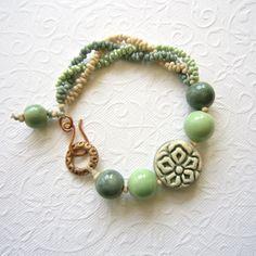 Artisan ceramic bead bracelet, Sea green and cream bracelet, Bronze beaded bracelet