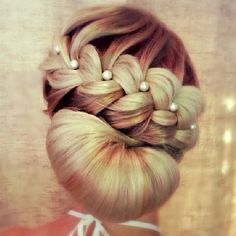Pretty formal hairstyle with pearl bobby pins! French braid and chignon type style. Sweet and romantic. Perfect for a bride on her wedding day, for prom, dances, or a very nice date night / evening cocktail party with a little black dress :)