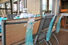 Frozen birthday party. Cute and easy idea, add tulle and snowflakes to the back of chairs. Reagan's 5th Birthday, Frozen style | CatchMyParty.com